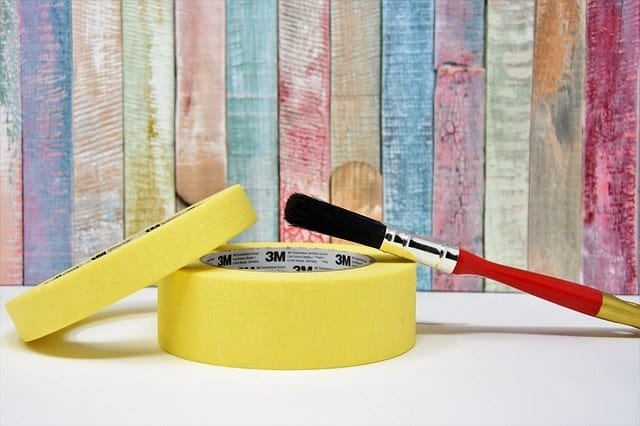 yellow painting tape with red brush