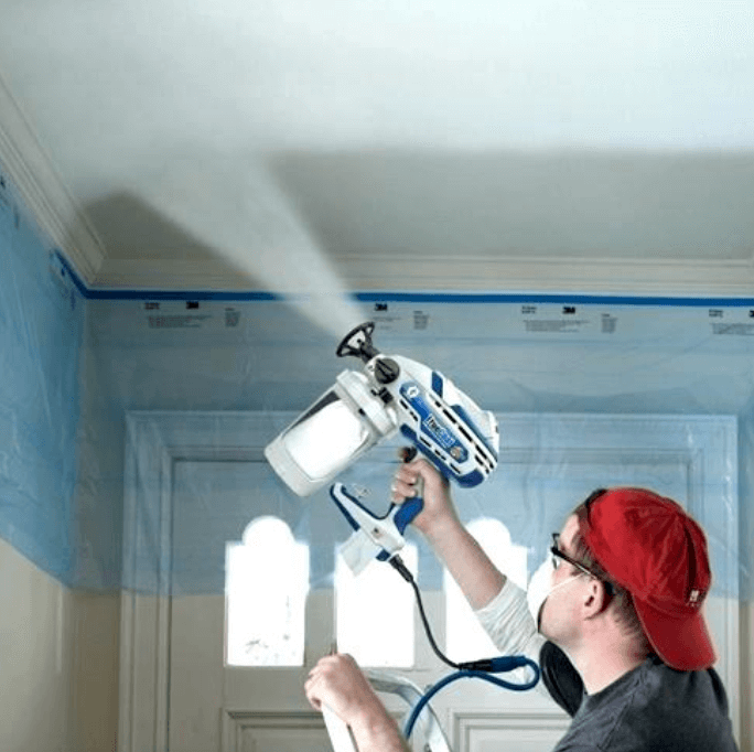 guy painting a white ceiling