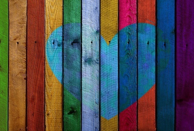multi color wooden wall with a heart
